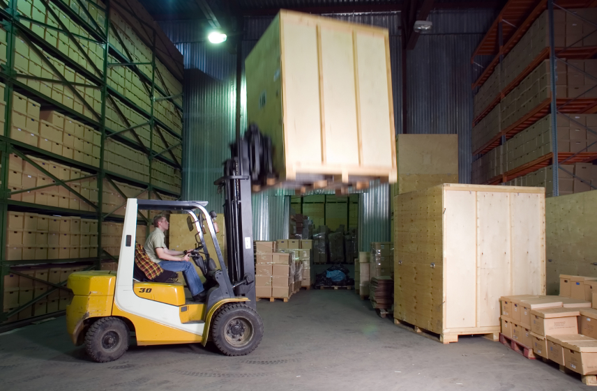 Man working with forklift in the warehouse